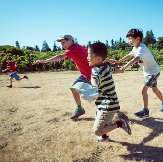 Kids running at UBC farm